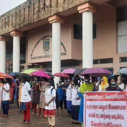 Chidambaram medical students struggle by tying black cloth in mouth in pouring rain