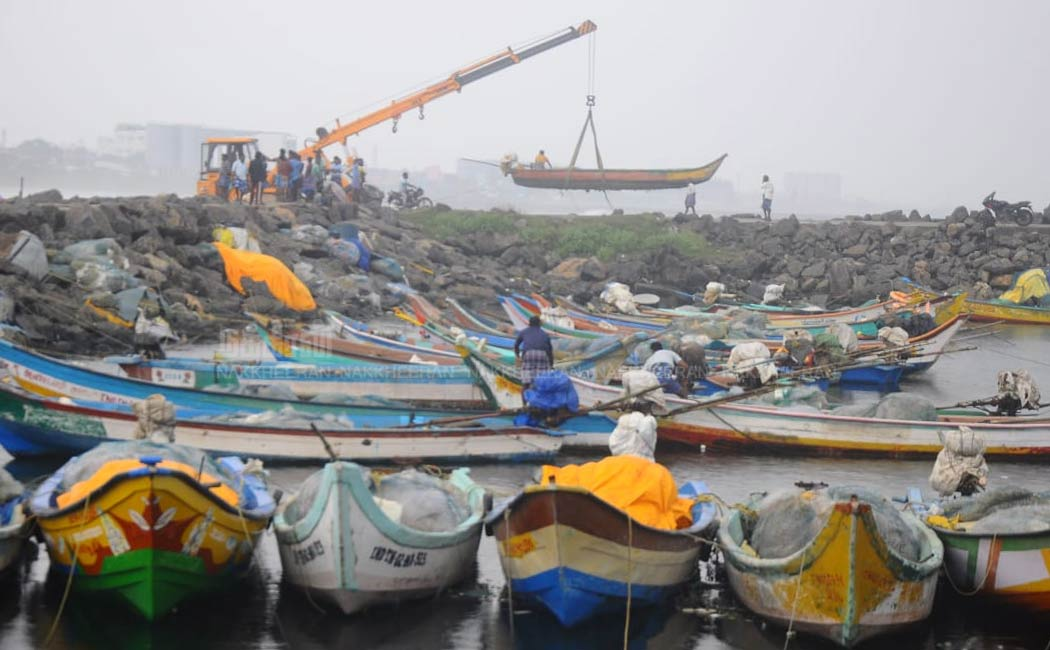Fishermen in an effort to protect boats from Nivar Cyclone