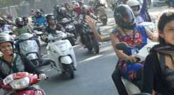 girls Alert in the while scooty driving