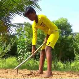 School boy in nature farming - Mannargudi