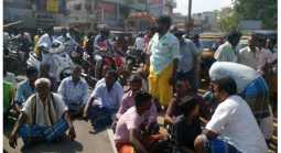 Trying to grab temple assets: Nine community people block road