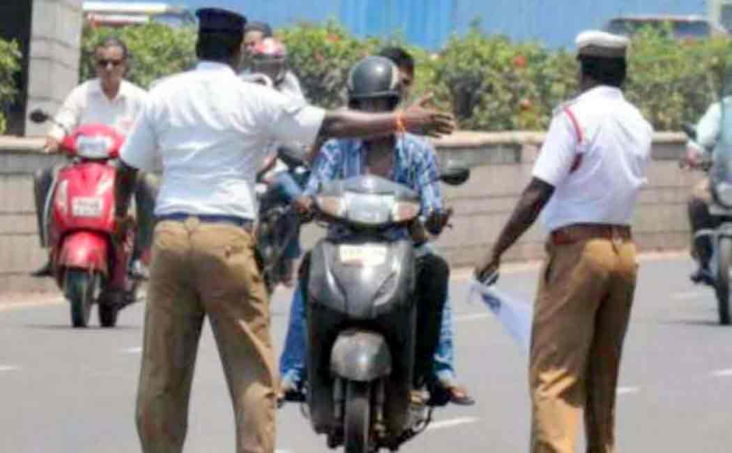 delhi police put fine for bus driver for not wearing helmet