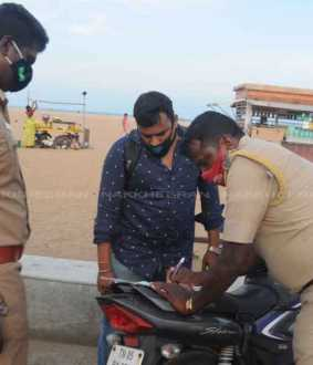 Officers fined for not wearing masks on the beach