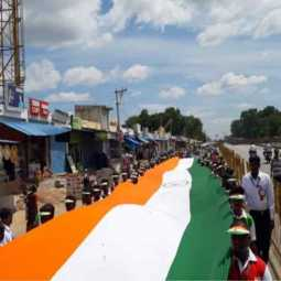 Students march with 150 feet long National Flag