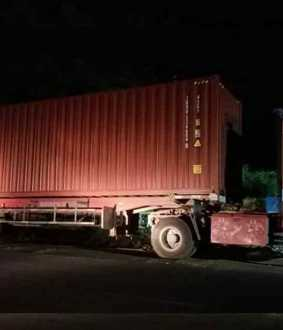 Container truck parked near counting center