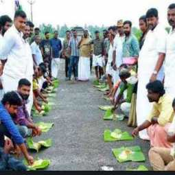 kerala congress party members  sitting on the road eating in celebrating the onam festival