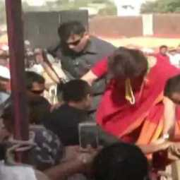 priyanka gandhi hops over barricade to meet party workers