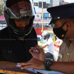 Officers fined for not wearing face mask