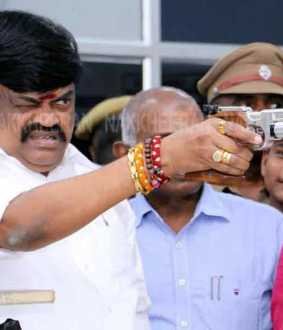 Gun in the hands of KT Rajendrapalaji!