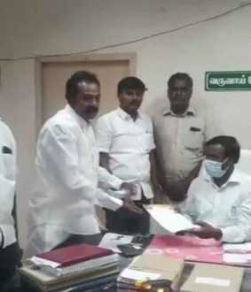Minister supporters issuing gift items to district people dmk complaints